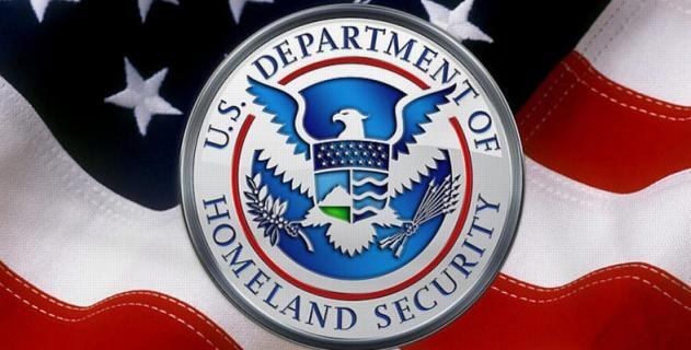U. S. Department Of Homeland Security Emblem Over American Flag